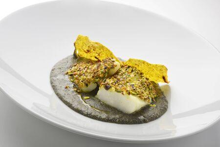black fish: Fish Dish Salt cod crusted with pistachios and black polenta