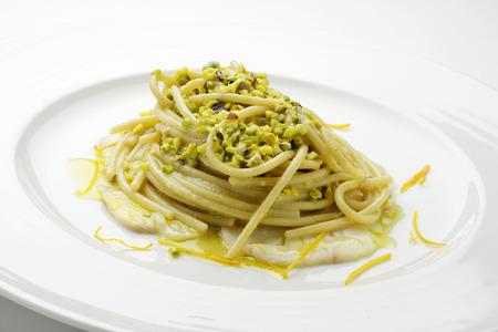 Pasta dish Spaghetti with pistachio and citrus yellowtail