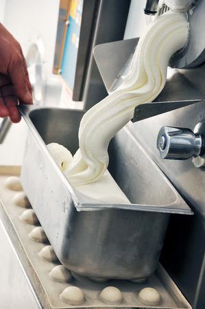 Hand and Ice cream machine production detail