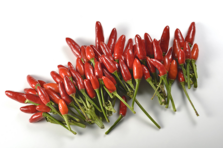 kilos: Bunch of hot peppers on white plane