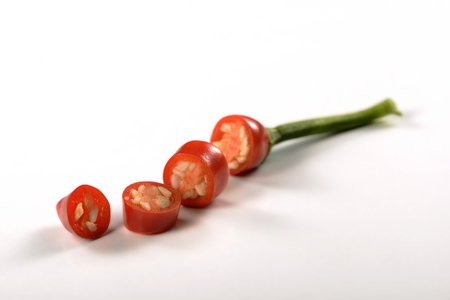 kilos: Single Cutted red chili pepper on white
