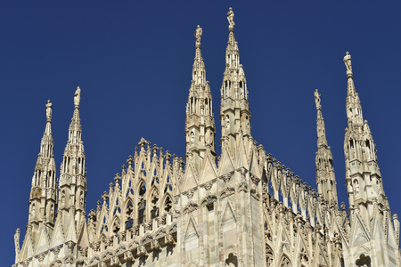 spires: Details of the spires of Milan cathedral with clear sky