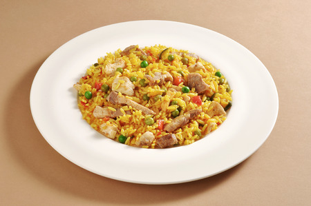 Dish with a portion of meat paella