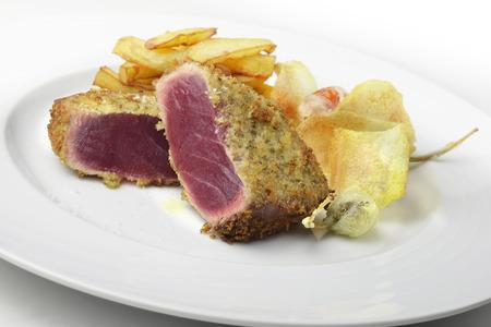 Fish dish portion escalope bluefin tuna breading capers and potatoes