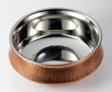 copper coated: Empty Indian bowl of steel and copper Stock Photo