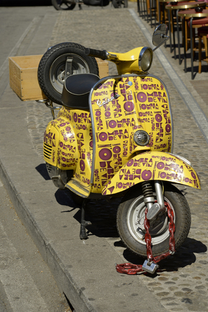decorated bike: Milan, Italy - April 19, 2016: Milan wine shop special Vespa pick-up for delivery of the wine at home
