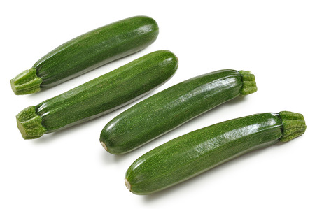 Four ripe zucchini isolated om white board
