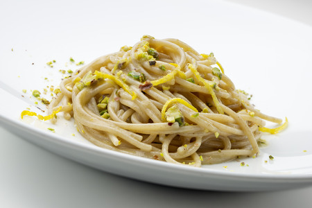 Pasta Dish Spaghetti with salted anchovies and lemon pistachios