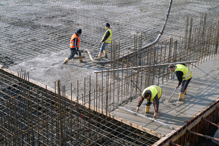 concreting: Milan, Italy - January 17, 2016 - Concrete casting on Reinforcing Bar of floor in industrial Construction site Editorial