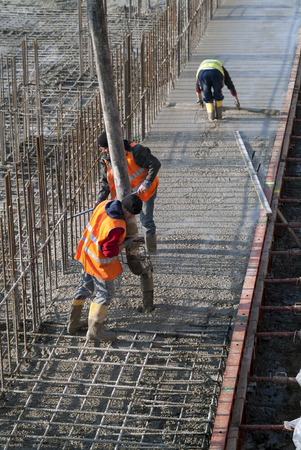 Milan, Italy - January 17, 2016 - Concrete casting on Reinforcing Bar of floor in industrial Construction site Editorial