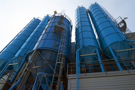 Bottom perspective of storage Tower Silos blue Stock Photo