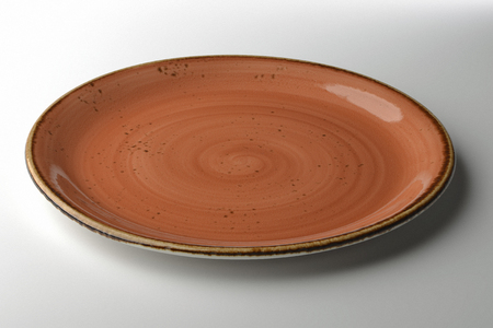 glazes: ocher hand-crafted plate isolated on white background Stock Photo