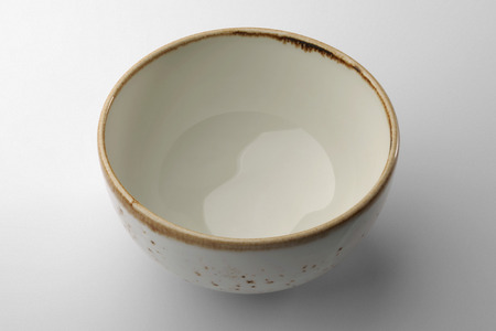 glazes: White hand-crafted chinese bowl isolated on white background Stock Photo