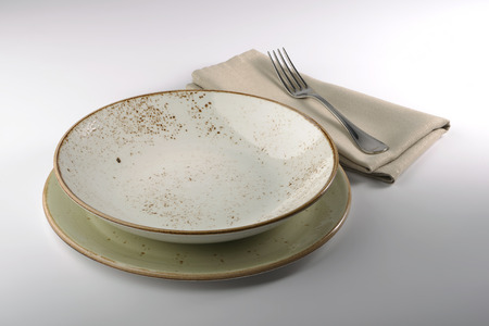 glazes: set of empty holster plate with napkin and fork
