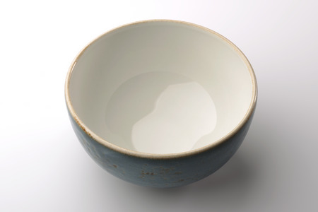 glazes: Blue hand-crafted chinese bowl isolated on white background Stock Photo