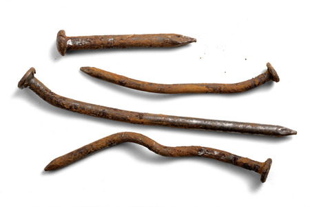 Crooked and rusty nails on a white background