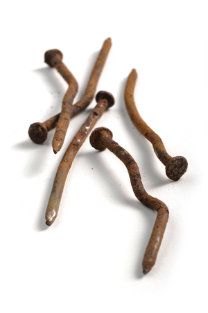 rusty nail: Crooked and rusty nails on a white background