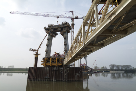Gangway in Construction site of the bridge on the river