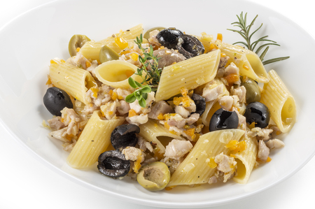 Single Pasta dish with rabbit meat sauce and olives Stock Photo