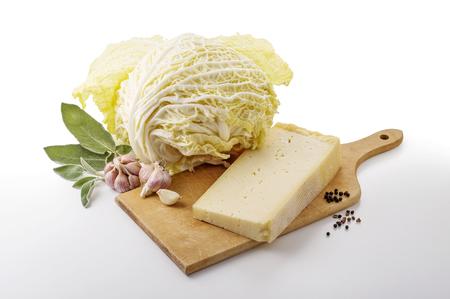 Ingredients for seasoning pizzoccheri on chopping board