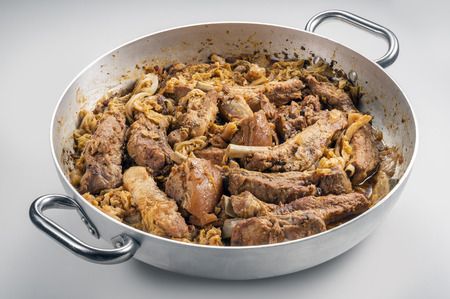 Cassoeula cassola pork meat in a pot isolated on neutral background