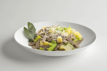 Single Bowl with portion of pizzoccheri isolated on white