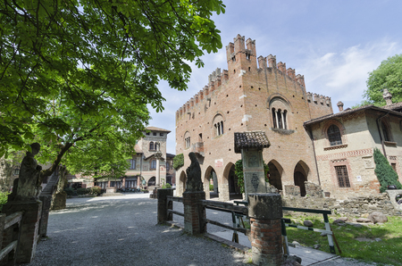 Grazzano Visconti, Italy - April 11, 2017: Partial view without tourists of the ancient village of Grazzano Visconti in spring Editorial