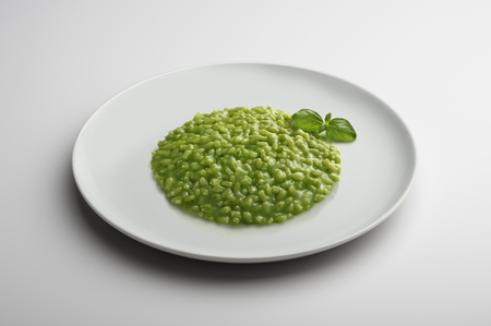 Risotto dish with Pesto to Genoese isolated on white table