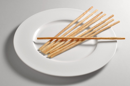 gressins: Round dish with breadsticks from Turin isolated on grey background Banque d'images