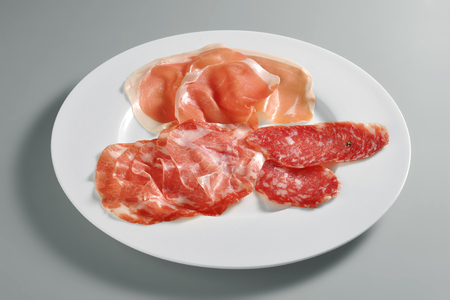 Appetizer dish with mixed salami isolated on grey background Banco de Imagens