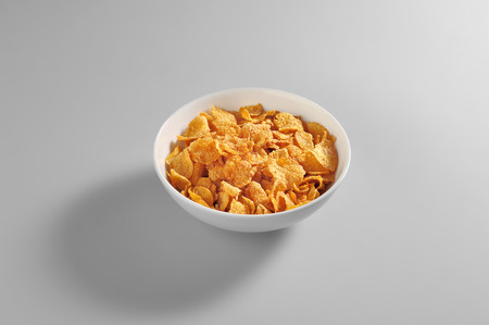 Bowl with corn flakes portion isolated on grey background Imagens - 81452181