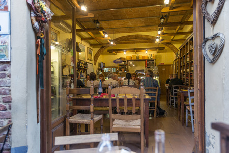 Certaldo Firenze, Italy - july 26, 2017; Typical Tuscan tavern with tourists in summer