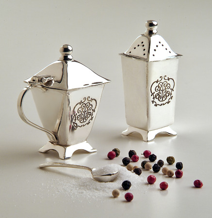 salt and pepper set in silver isolated on white table