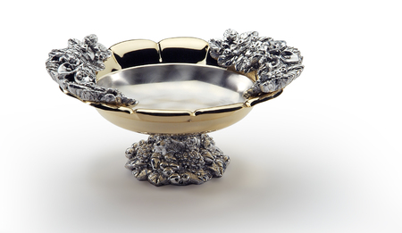 serving utensil: Isolated Round bowl in steel and gold decorated with center foot Stock Photo