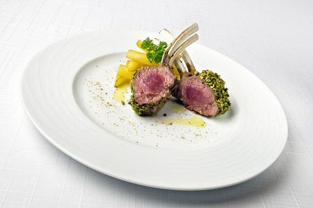 Dish of Lamb rack in crust of pistachios and French fries Stock Photo