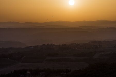 Warm Sunset over the hills of Siena in Tuscany