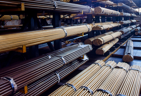 Warehouse of brass rods of industry of hydraulic fittings Stock Photo