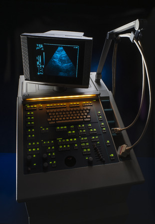 Ultrasound device with monitor screen in dark room