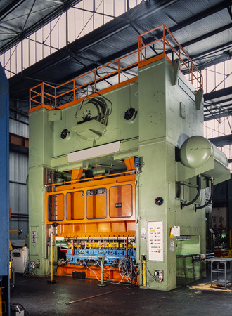 Industrial press for sheet metal stamping in a factory