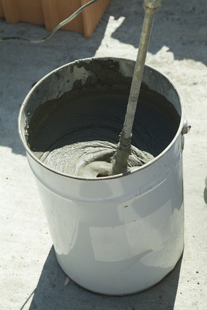 Bucket with mixing mortar for construction in construction site