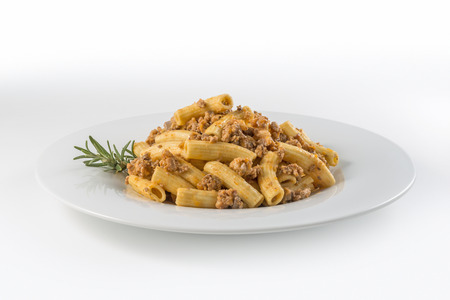 Round white Plate of macaroni pasta with Bolognese ragù