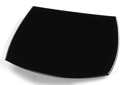 Elegant empty square black glossy plate isolated on white background