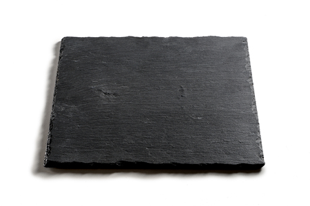Square empty plate in black slate isolated on white background