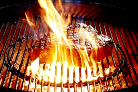 Porterhouse beef steak bake on the grill of the barbecue Archivio Fotografico
