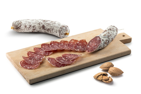 Two pieces of Salami and slices on Cutting board