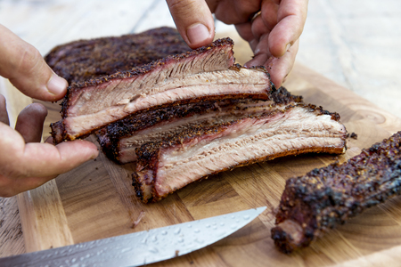 Cutting pork ribs and knife on cutting board