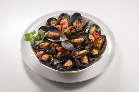Bowl with soup of mussels and parsley