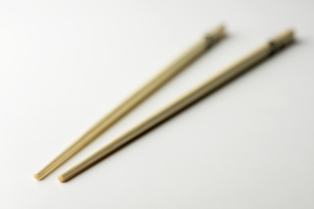 Bamboo chopsticks decorated on a white background Banco de Imagens