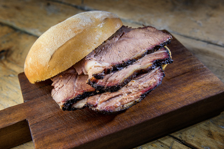 Detail of Brisket Sandwich on wooden cutting board