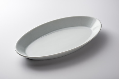 Isolated empty white oval plate on white background Stock Photo